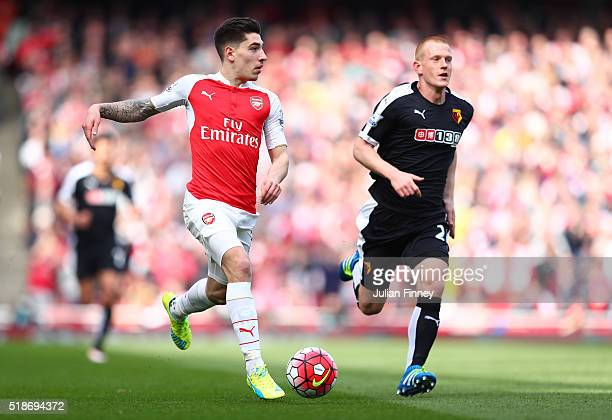 Hector Bellerin of Arsenal and Ben Watson of Watford compete for the ball during the Barclays Premier League match between Arsenal and Watford at...
