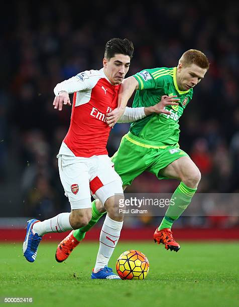 Hector Bellerin of Arsenal and Duncan Watmore of Sunderland compete for the ball during the Barclays Premier League match between Arsenal and...