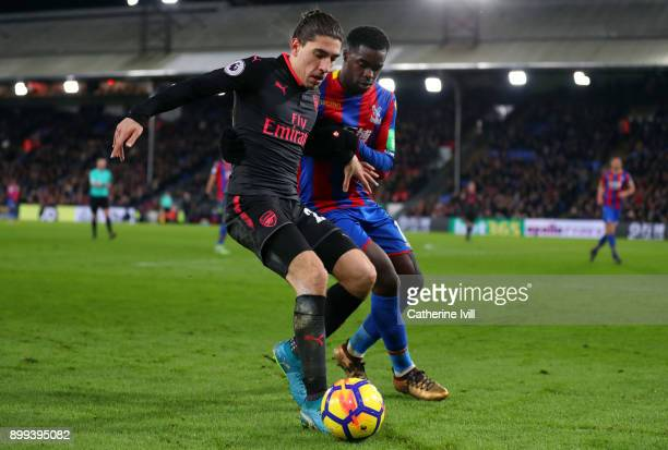 Hector Bellerin of Arsenal and Jeffrey Schlupp of Crystal Palace during the Premier League match between Crystal Palace and Arsenal at Selhurst Park...