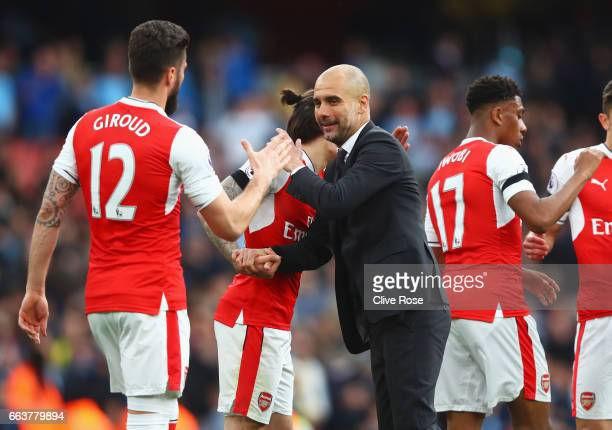 Hector Bellerin of Arsenal and Josep Guardiola Manager of Manchester City embrace after the Premier League match between Arsenal and Manchester City...
