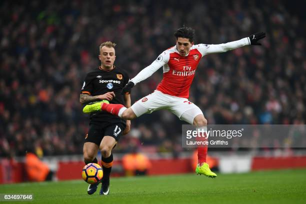 Hector Bellerin of Arsenal and Kamil Grosicki of Hull City compete for the ball during the Premier League match between Arsenal and Hull City at...