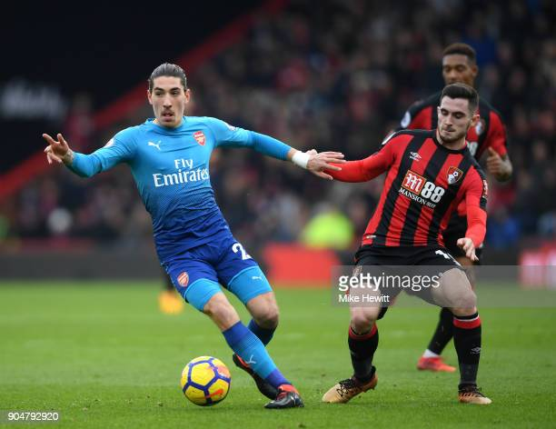 Hector Bellerin of Arsenal and Lewis Cook of AFC Bournemouth battles for possesion during the Premier League match between AFC Bournemouth and...