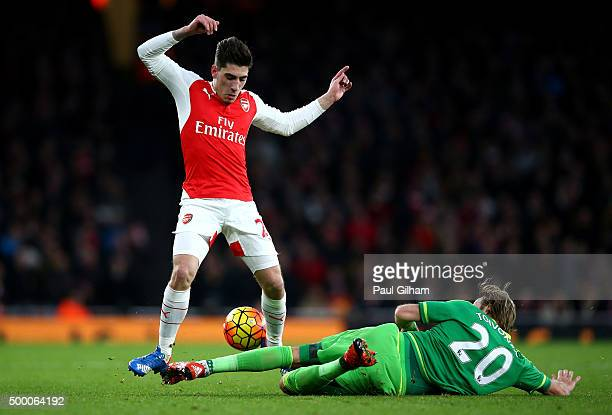 Hector Bellerin of Arsenal and Ola Toivonen of Sunderland compete for the ball during the Barclays Premier League match between Arsenal and...