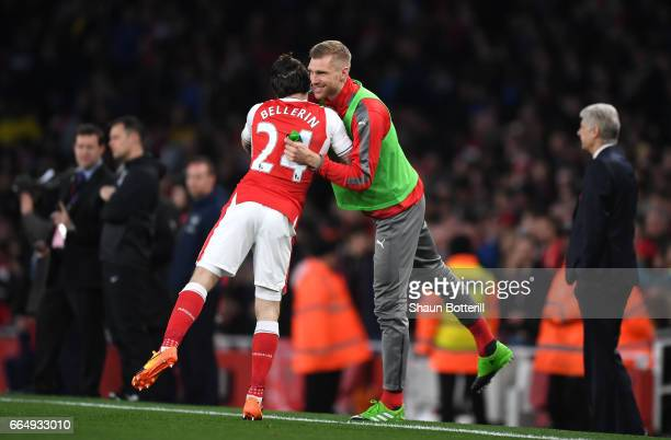Hector Bellerin of Arsenal and Per Mertesacker of Arsenal embrace prior to the Premier League match between Arsenal and West Ham United at the...