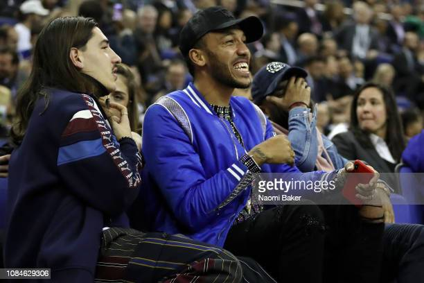 Hector Bellerin of Arsenal and PierreEmerick Aubameyang of Arsenal are seen front row watching the NBA London game 2019 between Washington Wizards...