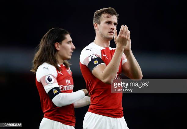 Hector Bellerin of Arsenal and Rob Holding of Arsenal show appreciation to the fans after the Premier League match between Arsenal FC and Liverpool...
