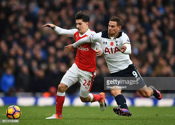 Hector Bellerin of Arsenal and Vincent Janssen of Tottenham Hotspur challenge for the ball during the Premier League match between Arsenal and...