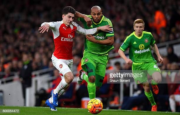 Hector Bellerin of Arsenal and Younes Kaboul of Sunderland compete for the ball during the Barclays Premier League match between Arsenal and...