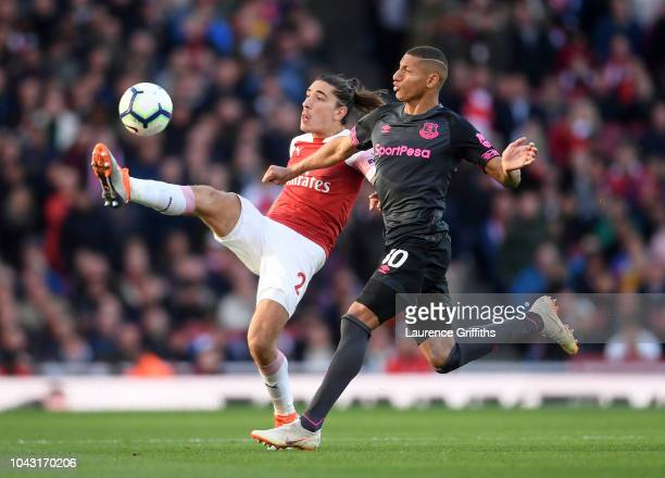 Hector Bellerin of Arsenal battles for the ball with Richarlison of Everton during the Premier League match between Arsenal FC and Everton FC at...
