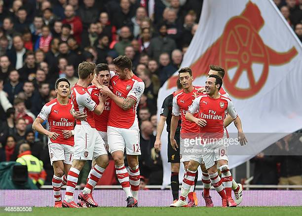 Hector Bellerin of Arsenal celebrates after scoring the opening goal during the Barclays Premier League match between Arsenal and Liverpool at...