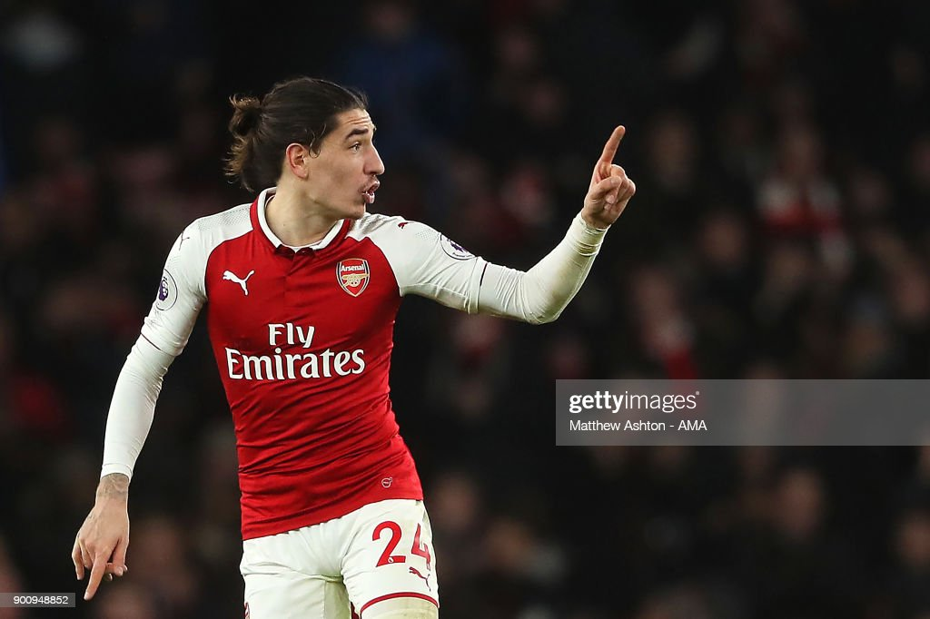 Hector Bellerin of Arsenal celebrates scoring a goal to make the score 2-2 during the Premier League match between Arsenal and Chelsea at Emirates Stadium on January 3, 2018 in London, England.