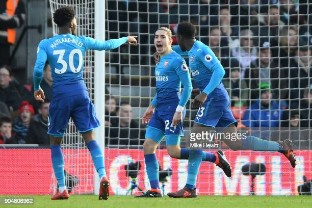 Hector Bellerin of Arsenal celebrates scoring his sides first goal with Danny Welbeck and Ainsley MaitlandNiles of Arsenal during the Premier League...