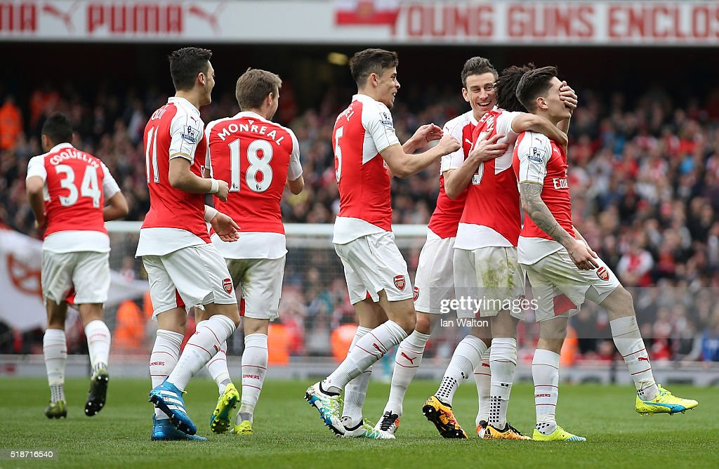 Hector Bellerin (1st R) of Arsenal celebrates scoring his team's third goal with his team mates during the Barclays Premier League match between Arsenal and Watford at Emirates Stadium on April 2, 2016 in London, England.