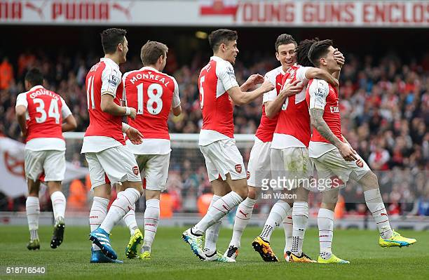 Hector Bellerin of Arsenal celebrates scoring his team's third goal with his team mates during the Barclays Premier League match between Arsenal and...