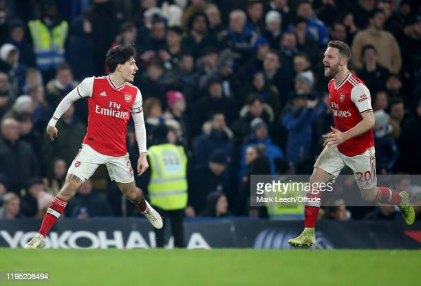 Hector Bellerin of Arsenal celebrates the second equalising goal with Shkodran Mustafi of Arsenal during the Premier League match between Chelsea FC...