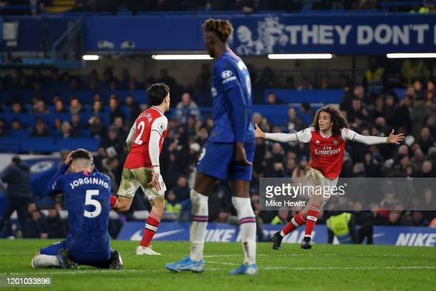 Hector Bellerin of Arsenal celebrates with Matteo Guendouzi after scoring his team's second goal during the Premier League match between Chelsea FC...