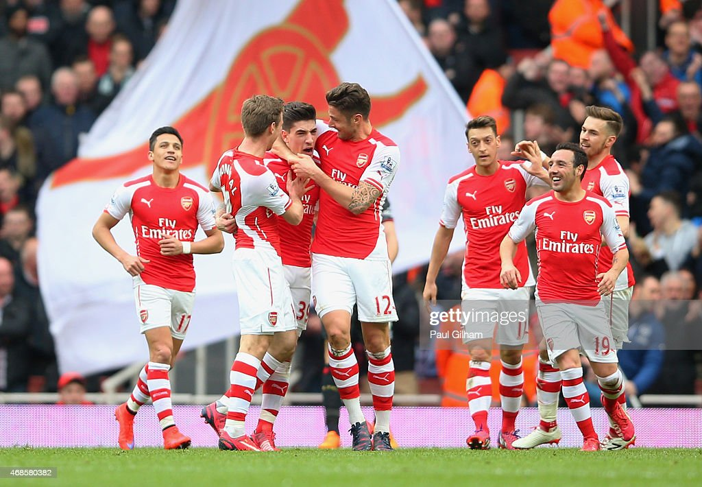 Hector Bellerin of Arsenal celebrates with team-mates after scoring the opening goal during the Barclays Premier League match between Arsenal and Liverpool at Emirates Stadium on April 4, 2015 in London, England.