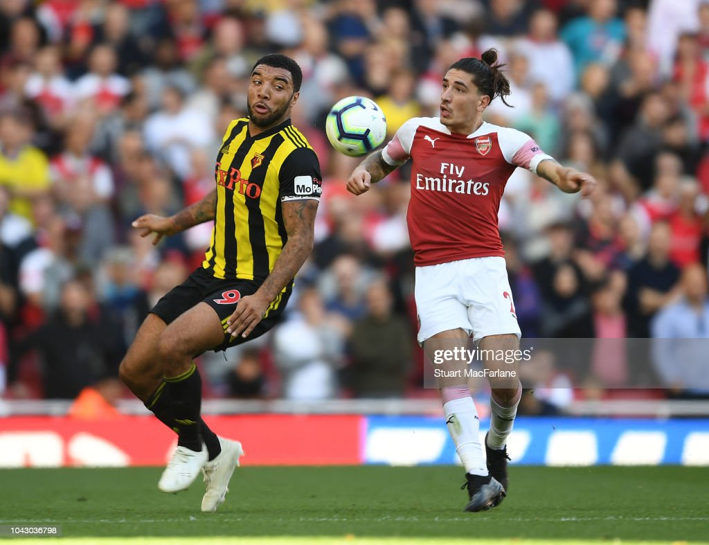 Hector Bellerin of Arsenal challenged by Troy Deeney of Watford