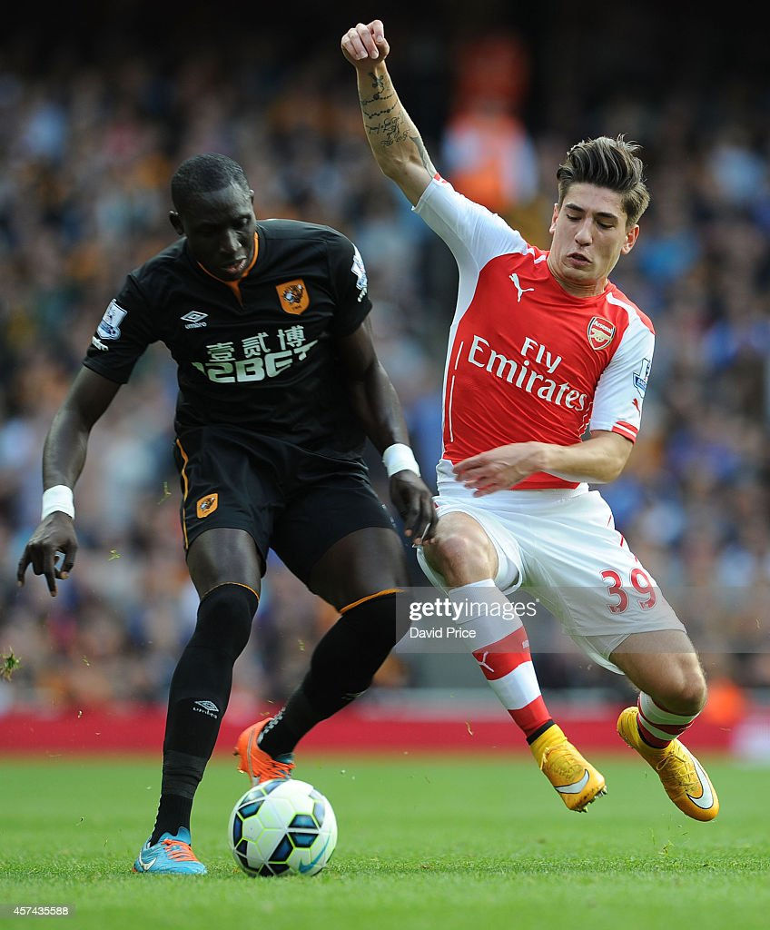 Hector Bellerin of Arsenal challenges Mohamed Diame of Hull during the match between Arsenal and Hull City in the Barclays Premier League at Emirates Stadium on October 18, 2014 in London, England.