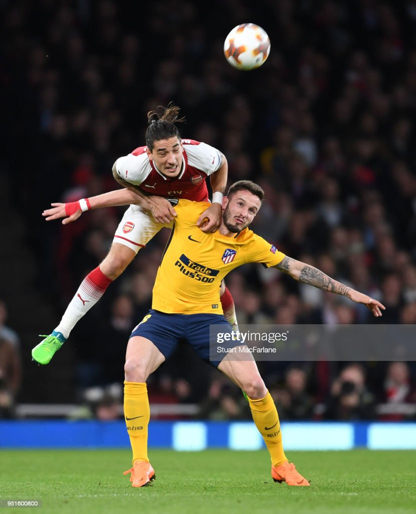 Hector Bellerin of Arsenal challenges Saul Niguez of Madrid during the UEFA Europa League Semi Final leg one match between Arsenal FC and Atletico Madrid at Emirates Stadium on April 26, 2018 in London, United Kingdom.
