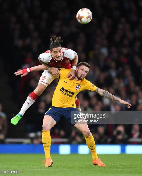 Hector Bellerin of Arsenal challenges Saul Niguez of Madrid during the UEFA Europa League Semi Final leg one match between Arsenal FC and Atletico...