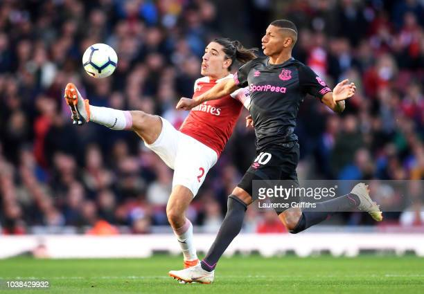 Hector Bellerin of Arsenal controls the ball as Richarlison of Everton looks on during the Premier League match between Arsenal FC and Everton FC at...
