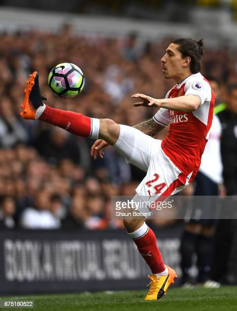 Hector Bellerin of Arsenal controls the ball during the Premier League match between Tottenham Hotspur and Arsenal at White Hart Lane on April 30...
