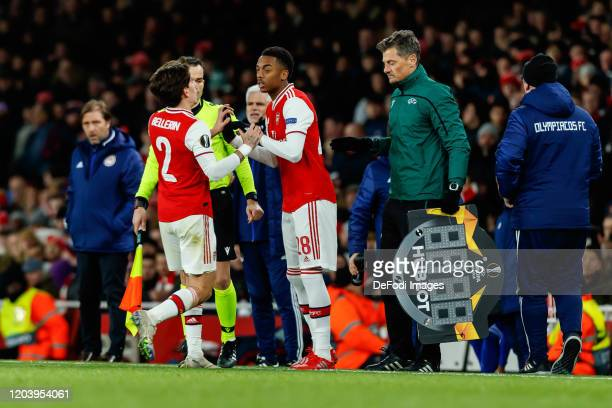 Hector Bellerin of Arsenal FC and Joe Willock of Arsenal FC substitutes during the UEFA Europa League round of 32 second leg match between Arsenal FC...