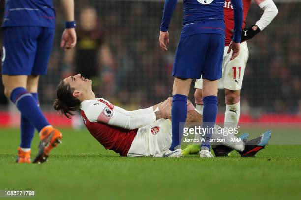Hector Bellerin of Arsenal goes down injured during the Premier League match between Arsenal FC and Chelsea FC at Emirates Stadium on January 19 2019...