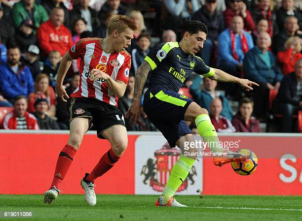 Hector Bellerin of Arsenal holds off Duncan Watmore of Sunderland during the Premier League match between Sunderland and Arsenal at Stadium of Light...