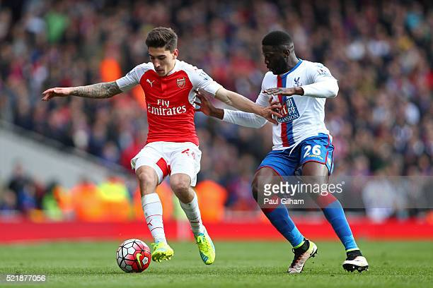 Hector Bellerin of Arsenal holds off pressure from Bakary Sako of Crystal Palace during the Barclays Premier League match between Arsenal and Crystal...