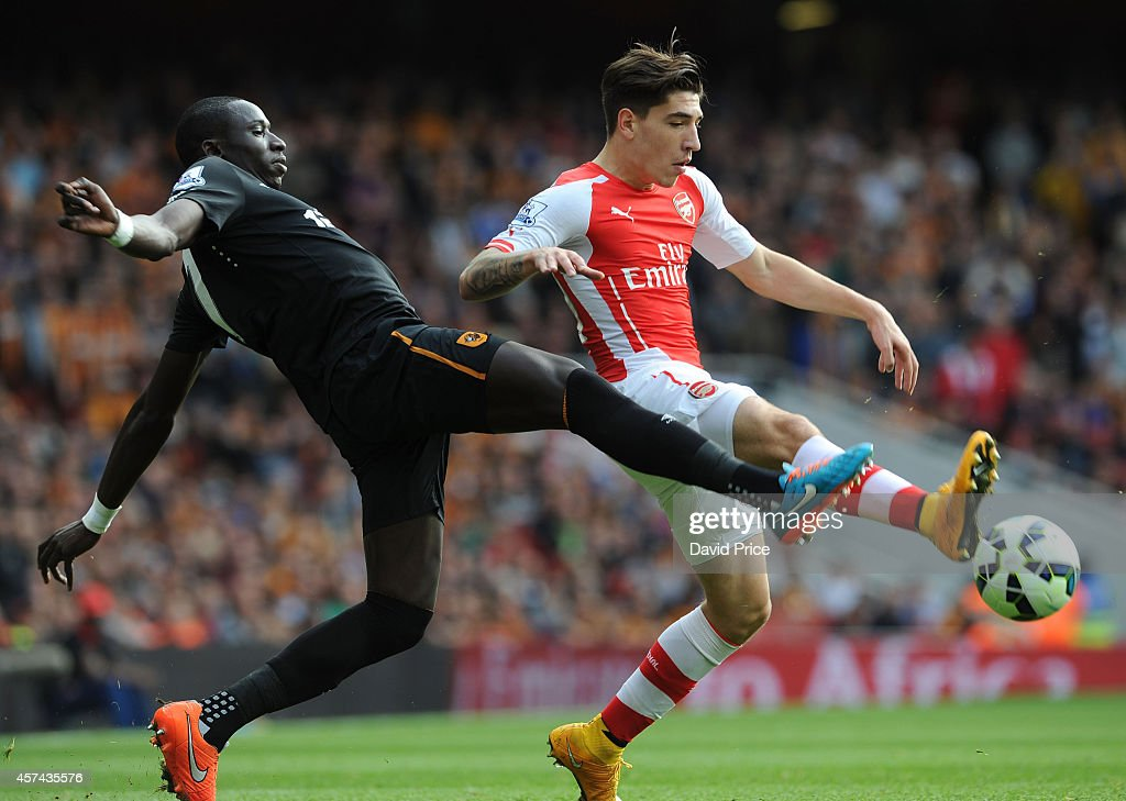 Hector Bellerin of Arsenal is challenged by Mohamed Diame of Hull during the match between Arsenal and Hull City in the Barclays Premier League at Emirates Stadium on October 18, 2014 in London, England.