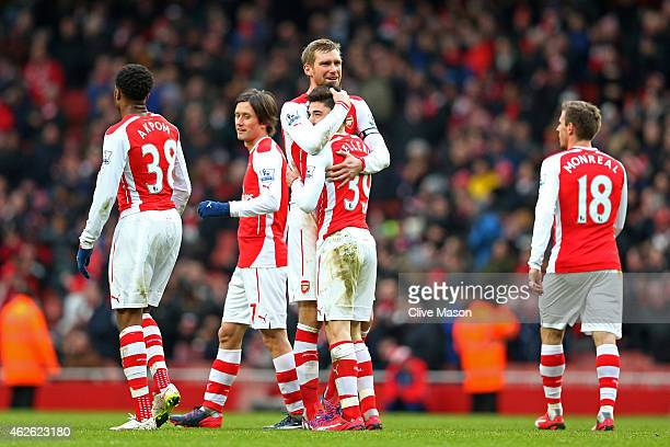Hector Bellerin of Arsenal is congratulated by teammate Per Mertesacker of Arsenal after scoring his team's fifth goal during the Barclays Premier...