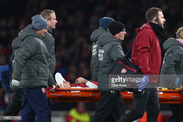 Hector Bellerin of Arsenal is stretchered off after receiving medical treatment during the Premier League match between Arsenal FC and Chelsea FC at...