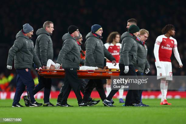 Hector Bellerin of Arsenal is stretchered off the pitch after receiving medical treatment during the Premier League match between Arsenal FC and...