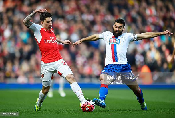 Hector Bellerin of Arsenal is tackled by Mile Jedinak of Crystal Palace during the Barclays Premier League match between Arsenal and Crystal Palace...