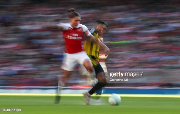 Hector Bellerin of Arsenal is tackled during the Premier League match between Arsenal FC and Watford FC at Emirates Stadium on September 29 2018 in...