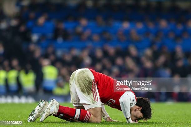 Hector Bellerin of Arsenal kisses the pitch as he celebrates scoring an equalising goal to bring the final score to 22 during the Premier League...
