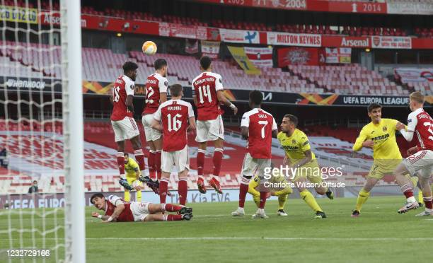Hector Bellerin of Arsenal lies behind the Arsenal defensive wall as the free kick goes over the bar during the UEFA Europa League Semi-final Second...