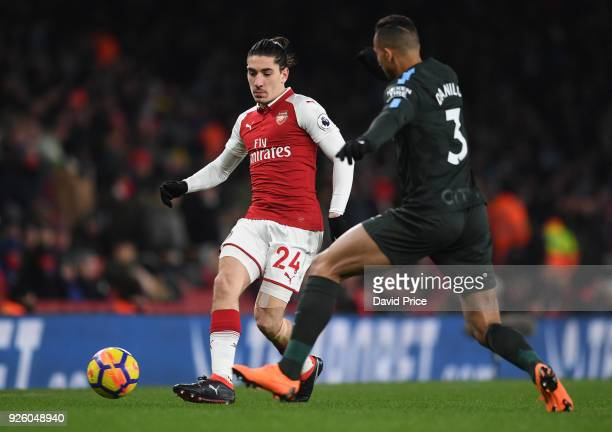 Hector Bellerin of Arsenal passes under pressure from Danilo of Man City during the Premier League match between Arsenal and Manchester City at...