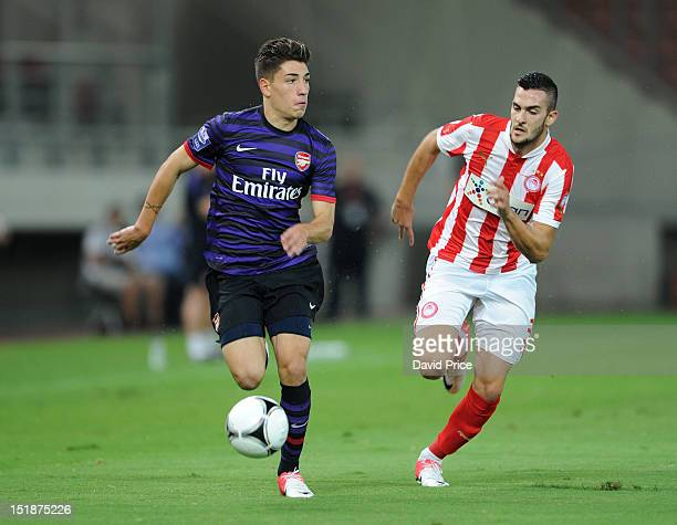 Hector Bellerin of Arsenal races away from Charalampos Lykogiannis of Olympiacos during the NextGen Series match between Olympiacos and Arsenal at...