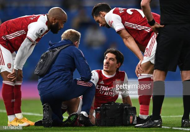 Hector Bellerin of Arsenal receives medical attention during the Premier League match between Chelsea and Arsenal at Stamford Bridge on May 12, 2021...