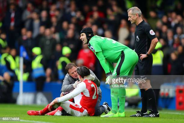 Hector Bellerin of Arsenal receives treatment before leaving the pitch with an injury picked up during Marcos Alonso of Chelsea's goa during the...