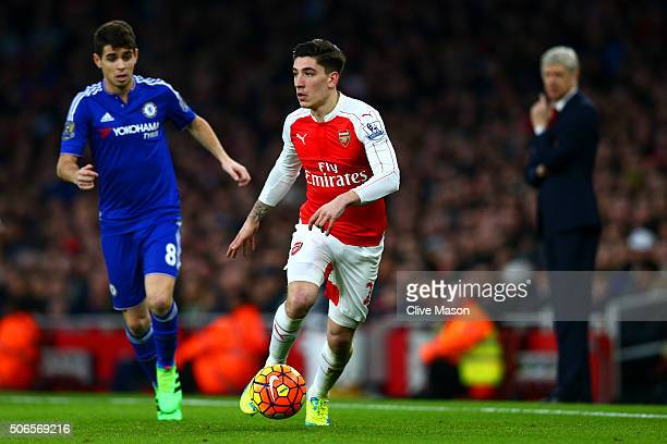 Hector Bellerin of Arsenal runs with the ball under pressure from Oscar of Chelsea as Arsene Wenger Manager of Arsenal looks on during the Barclays...