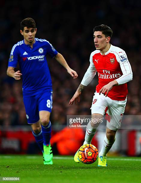 Hector Bellerin of Arsenal runs with the ball under pressure from Oscar of Chelsea during the Barclays Premier League match between Arsenal and...