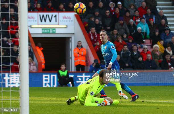 Hector Bellerin of Arsenal scores his sides first goal past Asmir Begovic of AFC Bournemouth during the Premier League match between AFC Bournemouth...