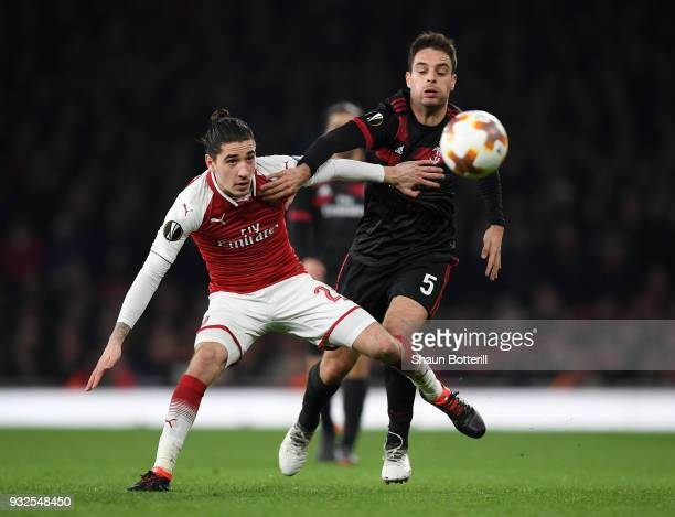 Hector Bellerin of Arsenal shields the ball from Giacomo Bonaventura of AC Milan during the UEFA Europa League Round of 16 Second Leg match between...
