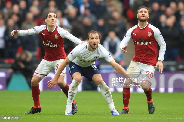Hector Bellerin of Arsenal Shkodran Mustafi of Arsenal and Harry Kane of Tottenham look up for the ball during the Premier League match between...