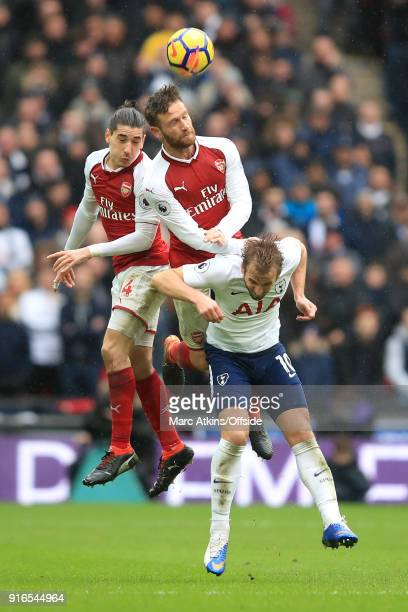 Hector Bellerin of Arsenal Shkodran Mustafi of Arsenal and Harry Kane of Tottenham battle for a header during the Premier League match between...
