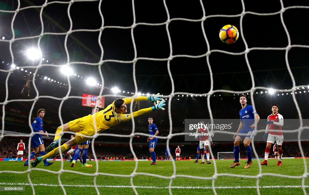 Hector Bellerin of Arsenal shoots past Thibaut Courtois of Chelsea to score his sides second goal during the Premier League match between Arsenal and Chelsea at Emirates Stadium on January 3, 2018 in London, England.